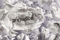 Paper written prejudice. Concept of old and abandoned idea or pr. Crumpled paper written prejudice. Illustrative concept of ideology thrown into the trash. Old Stock Images