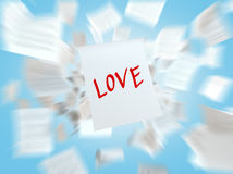 A paper with the written word LOVE. Royalty Free Stock Image