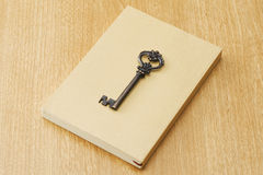 Paperback and old antique key Royalty Free Stock Photo