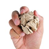 Paperball in hand. Paper ball in hand isolate on white background stock photography