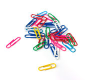 Paperclip. Multi-colored paper clips on a white background royalty free stock images