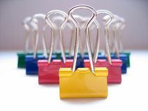 Paperclip Army. Different colored paperclips lined up stock photography