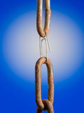 Paperclip as chain link over blue background. Weak or strong link metaphor Stock Photo