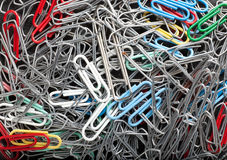 Paperclip background. Some metal and colored paperclips forming a background pattern Stock Photography