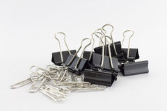 Paperclip. Black and small item and  background Royalty Free Stock Photo