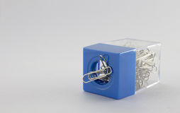 Paperclip and blue plastic box. And  background Stock Images