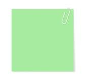 Paperclip die een leeg document blad houdt Stock Afbeelding