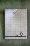 Paperclip on an empty white grid paper Royalty Free Stock Photos