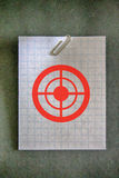 Paperclip on an empty white grid paper Royalty Free Stock Photography