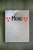 Paperclip na pustym białym siatka papierze Zdjęcie Stock