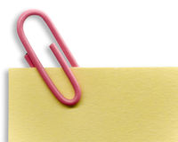 Paperclip on a note. And a white background Stock Photo