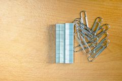 Paperclip. Pencil on wooden board Stock Image
