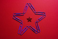 Paperclip star on red paper
