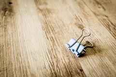 Paperclip on the wood background Stock Photography