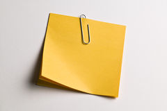 Paperclipped note paper Royalty Free Stock Photos