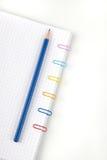 Paperclippen en potlood Stock Foto