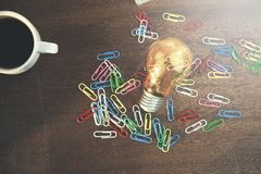 Paperclips and bulb stock photography