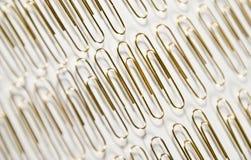 Paperclips en una fila Fotografía de archivo
