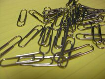 paperclips-on-notebook-file Royalty Free Stock Image