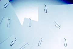 Paperclips in papers Stock Photos