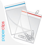 Paperclips in plastic bag isolated on the white stock photo