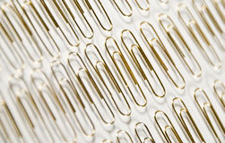 Paperclips in a row stock photography