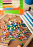 Paperclips on shool table. Colorful pinhead and paperclips on shool table Royalty Free Stock Photography