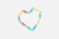 Paperclips on white background Stock Photography
