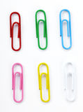 Paperclips on white background Stock Photos