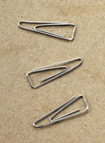 Paperclips on yellow background texture.  Royalty Free Stock Images