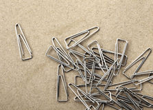Paperclips on yellow background texture.  Stock Images