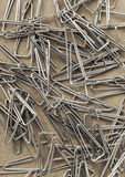 Paperclips on yellow background texture.  Stock Image