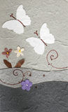 Papercraft butterfly with flower Stock Photos