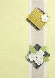 Papercraft flower in yellow background Stock Images