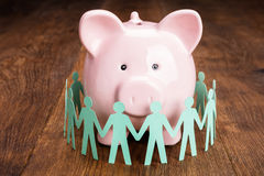 Papercut With Piggybank On Wooden Desk Stock Photography
