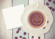 Papernote with coffee cup on table Stock Photography
