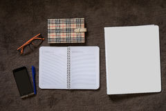 Papernote with mobile, pen and eyeglasses on the carpet Royalty Free Stock Images