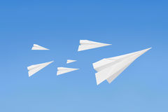 Paperplanes flying Stock Images