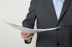 Papers. Man in a suit holding some papers Royalty Free Stock Photo