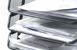 Papers. Stack of paper in an inbox Stock Image