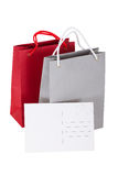 Papers bag with a gift card. Bags with tag closeup on white background Royalty Free Stock Photography