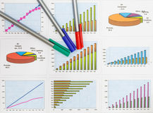 Papers charts  successful business. Papers charts of successful for business Stock Image