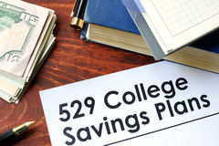 Papers with 529 College Savings Plans. On a table royalty free stock photography