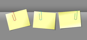 Papers conjunction with paper clips. Three yellow papers conjunction with colored paper clips Royalty Free Stock Images