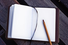 Papers in a copybook with pen on wooden table Stock Photos