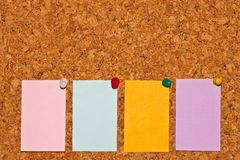 Papers on cork board Royalty Free Stock Photo