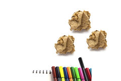 Papers crumple ball and color pen on white background Stock Images