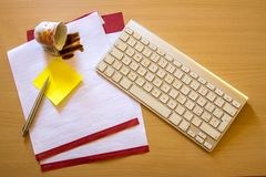 Papers on a desk with cup of coffee royalty free stock images