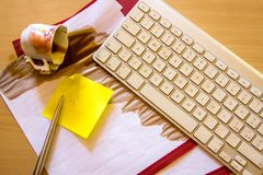 Papers on a desk with cup of coffee stock photo