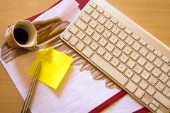 Papers on a desk with cup of coffee stock images